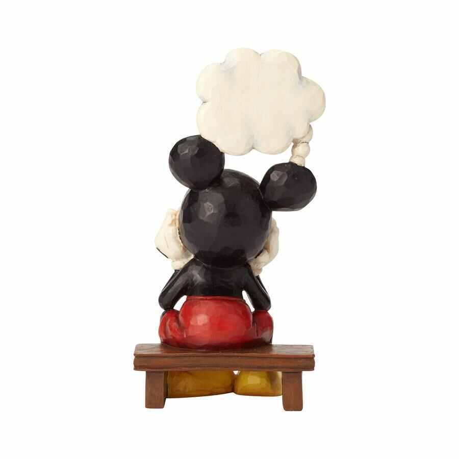 Mickey Mouse pense à Minnie